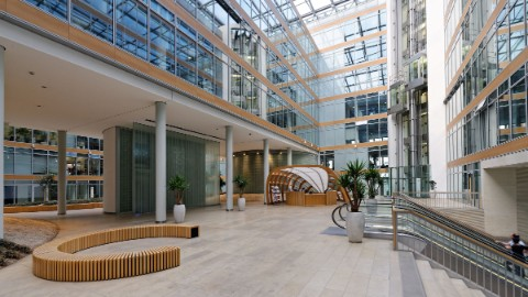 Image: Atrium in the DomAquarée Berlin office building.