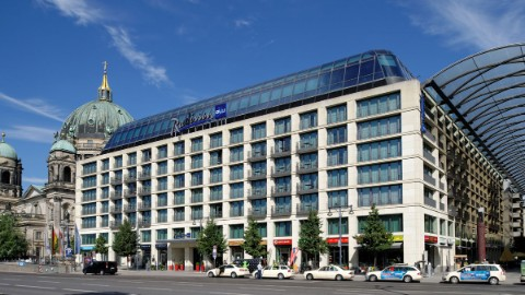 Image 1: An outside shot of the Radisson Blu at DomAquarée Berlin.