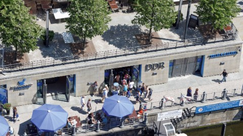 Image 3: Overhead shot of the entrance to Berlin attraction GDR Museum and the Spree promenade.