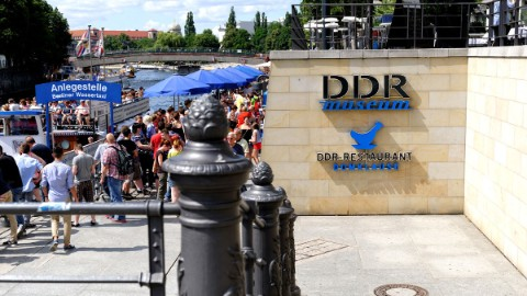 Image 6: Berlin attraction GDR Museum's logo at the entrance to DomAquarée.