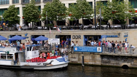 Image 1: River Spree and entrance to Berlin attraction GDR Museum in the DomAquarée building.